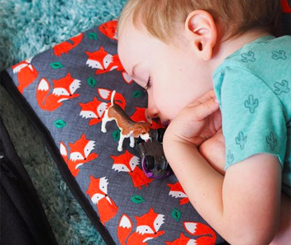 Young child on Kozy Koala Childcare Nap Mat 2